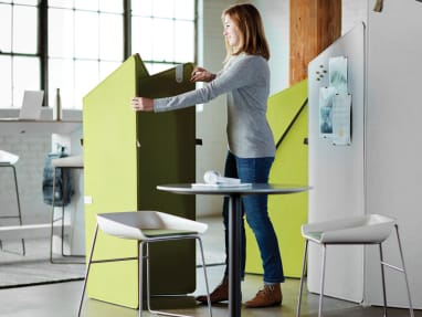 Young woman opening a green Clipper privacy screen