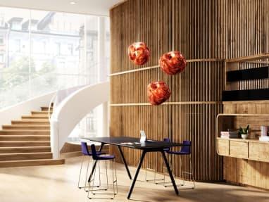 Montara650 stools with purple upholstery are arranged around a black Potrero415 table