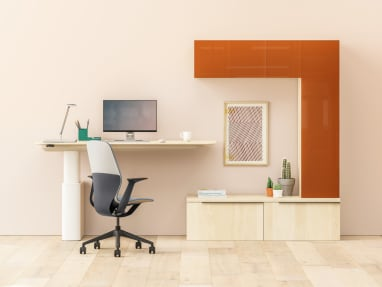 A SILQ desk chair next to a Mackinac workstation and Dash desk lamp