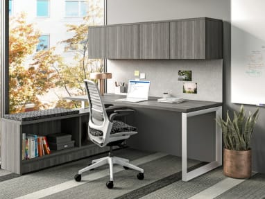 A Currency desk is shown with a Series 1 task chair