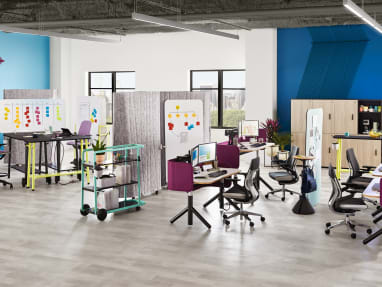 An office environment that includes Steelcase Flex height adjustable desks Gesture desk chairs Flex Slim tables SILQ stool height chairs and Steelcase Flex carts planning idea