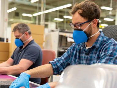 Men working and wearing masks