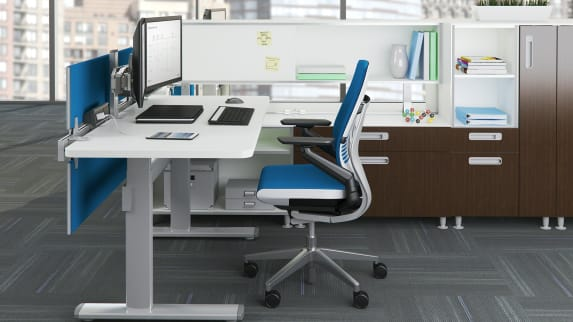 Blue Gesture chair and white Series 7 Height-Adjustable Desk with double monitor.