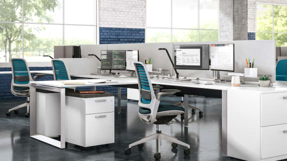Work area with blue Steelcase Series 1, white desk, CF Series dual monitors, Dash lights