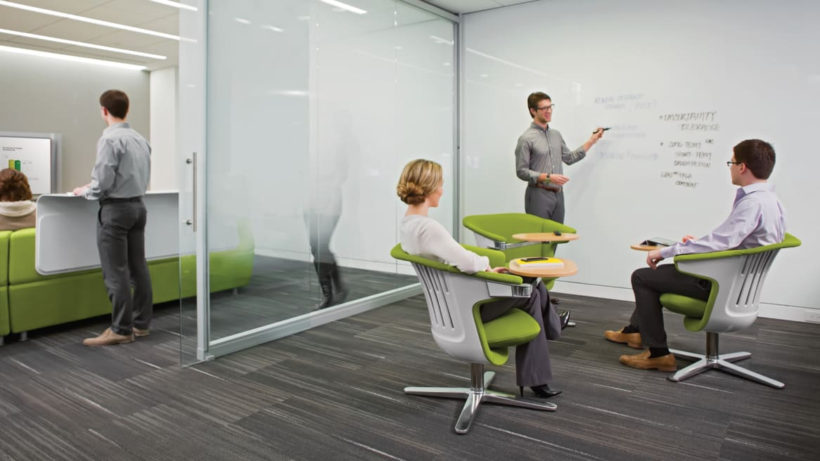 People sitting in i2i collaborative chairs during meeting
