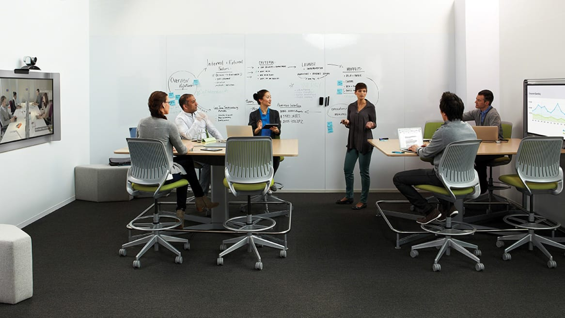 People sitting on Cobi collaborative chairs in a meeting