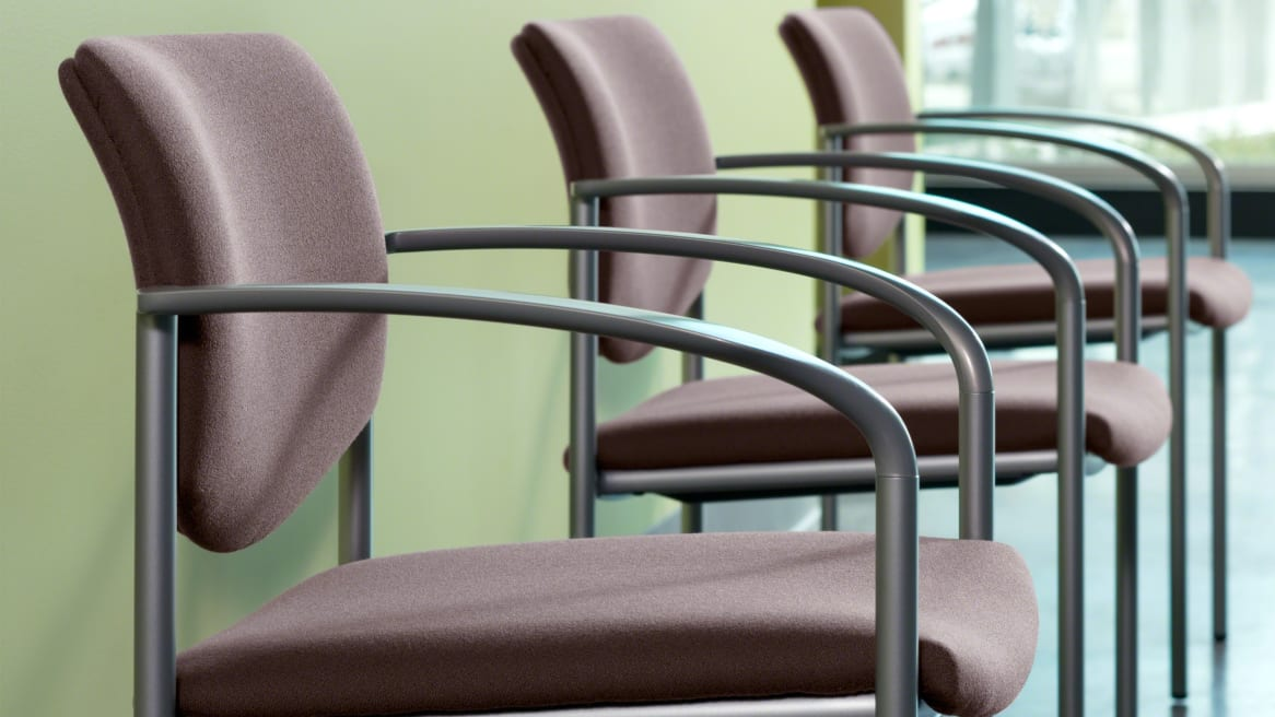 Close-Up of 3 Stackable Player Chairs with Platinum Frames