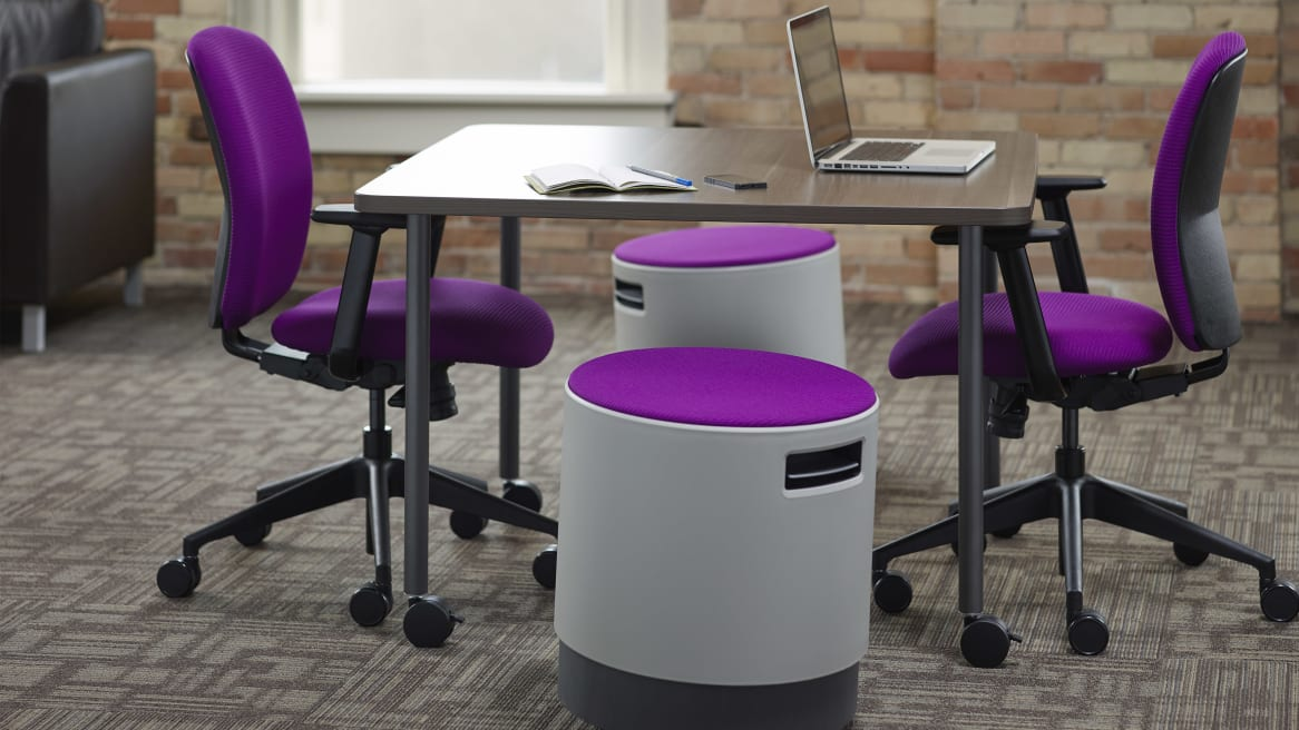 2 Purple Jack Task Chairs and 2 Purple Buoys by a table