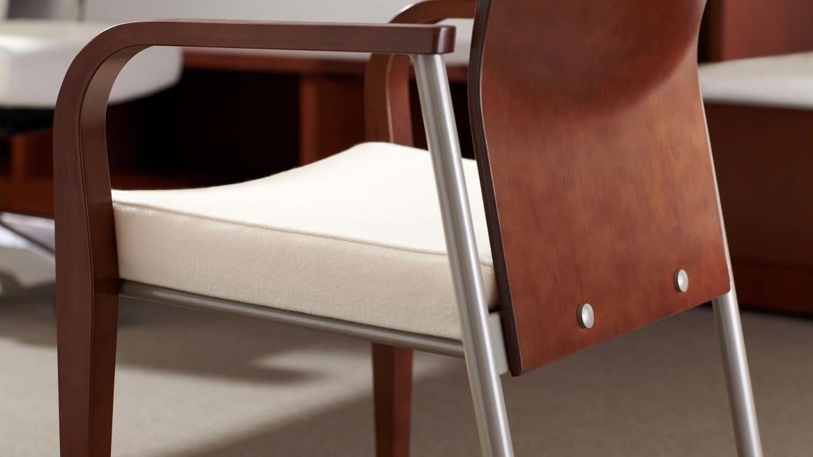 Mingle Guest Chair with white seat and medium walnut wood arms and back
