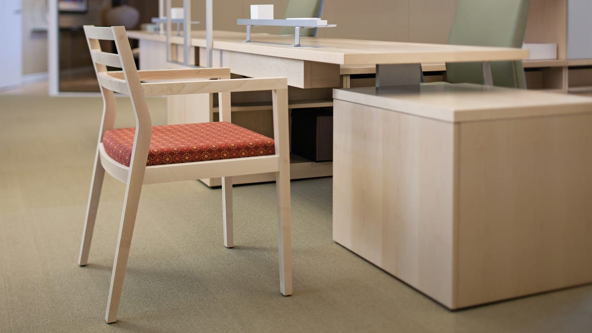 Sawyer Guest Chair WIth Bo Peep Finish in an office center in front of a desk