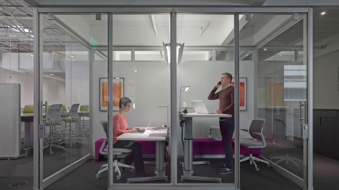 Airtouch Height-Adjustable Desks in a private office