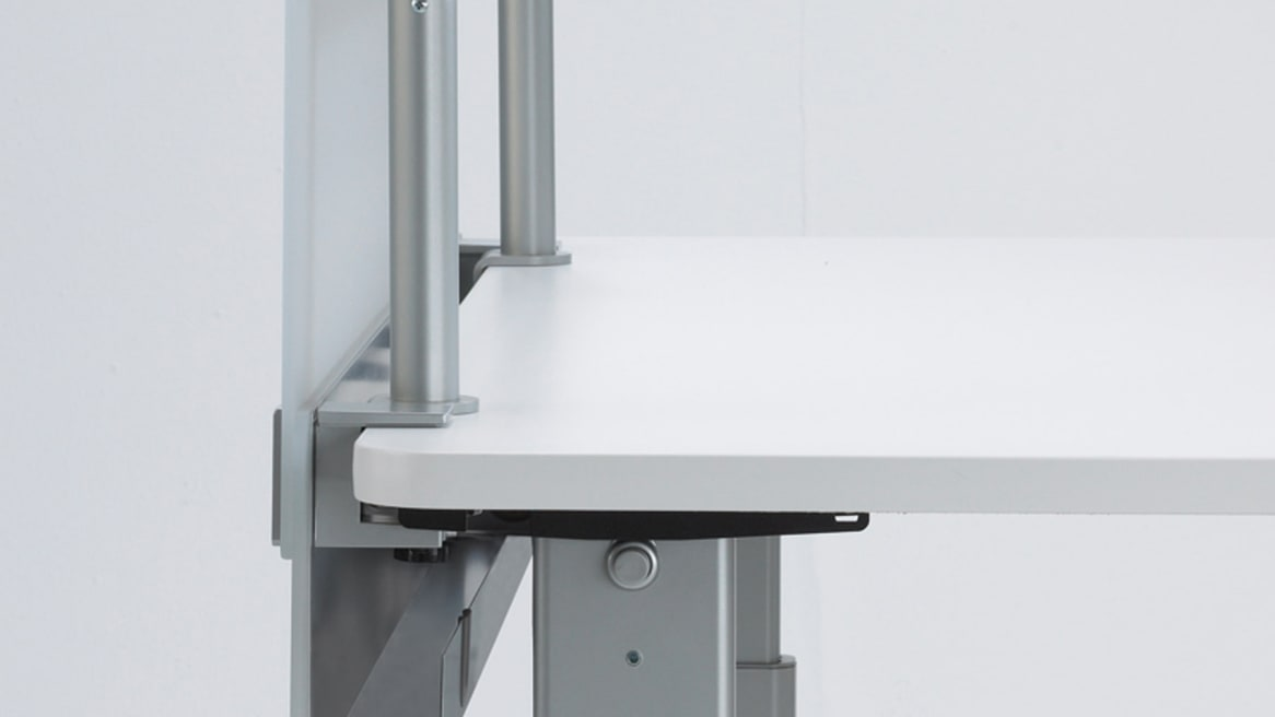 Cableway mounted on desk with a universal C-clamp