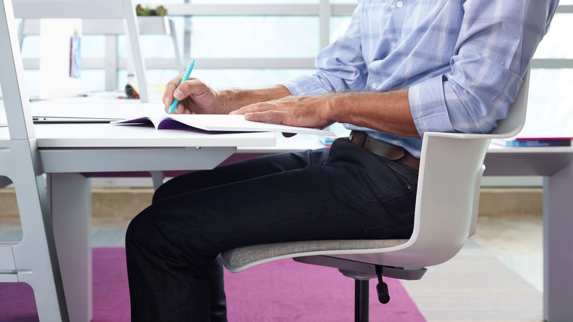 Close-Up of man sitting in Shortcut Task Chair at a Bivi Desk
