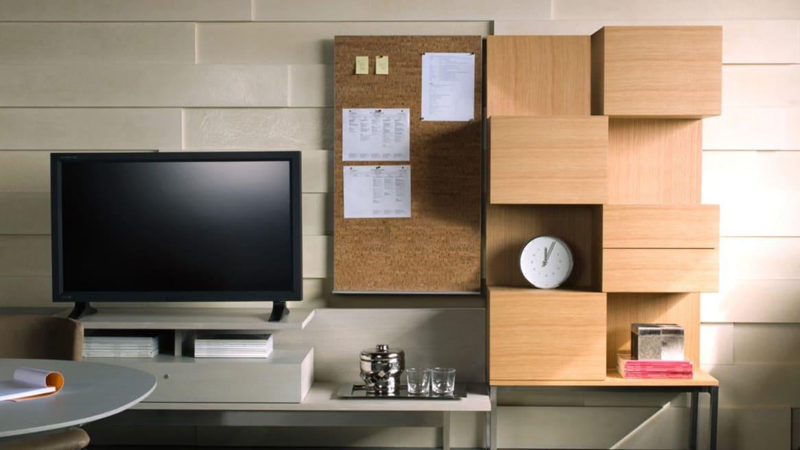 Denizen Storage Tower + Wardrobe next to a monitor