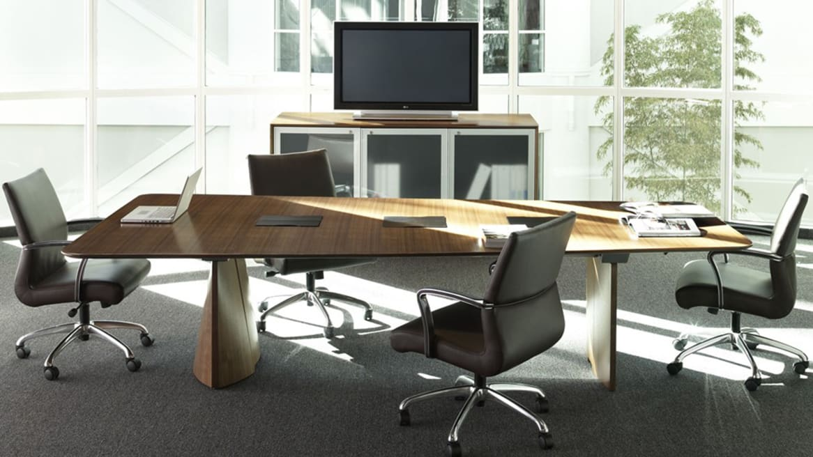 Host Meeting Table in a meeting area with four chairs