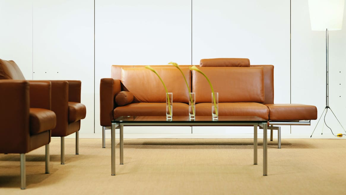 Two Tan Switch Lounge seats with Switch coffee table
