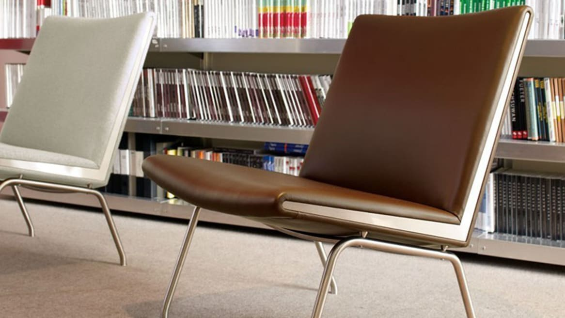 A White and a Brown Airport Chair CH401 in an office