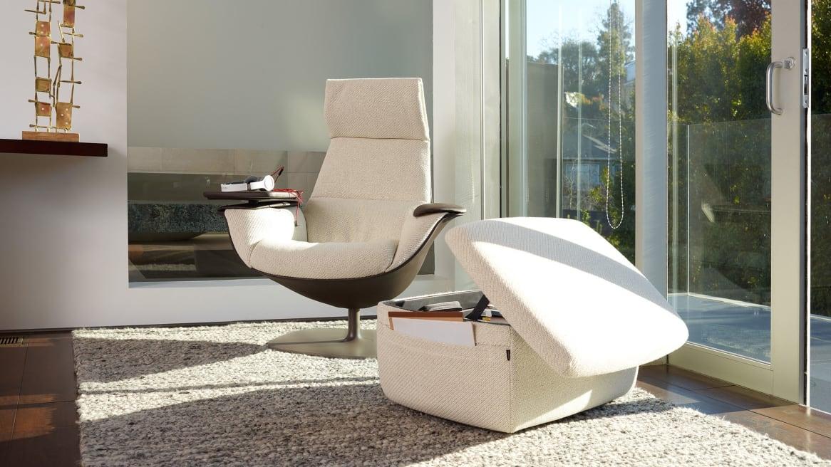 Massaud Lounge Chair with Adjustable Headrest and Swivel Tablet near Massaud Storage Ottoman