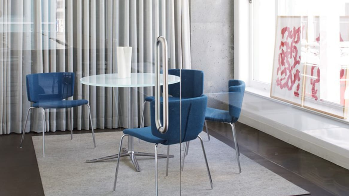 Frosted Glass Top Bob Table with 4-Star Base surrounded by three blue seats