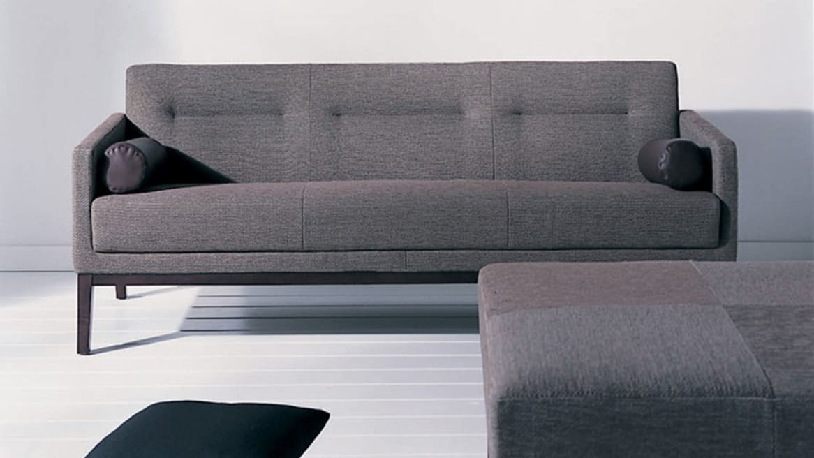 Brown Passerelle Lounge couch with Ottoman in front of the sofa