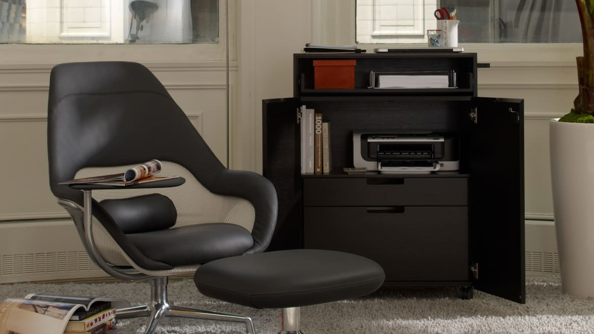 Black Exponents Cart behind a lounge seat and ottoman