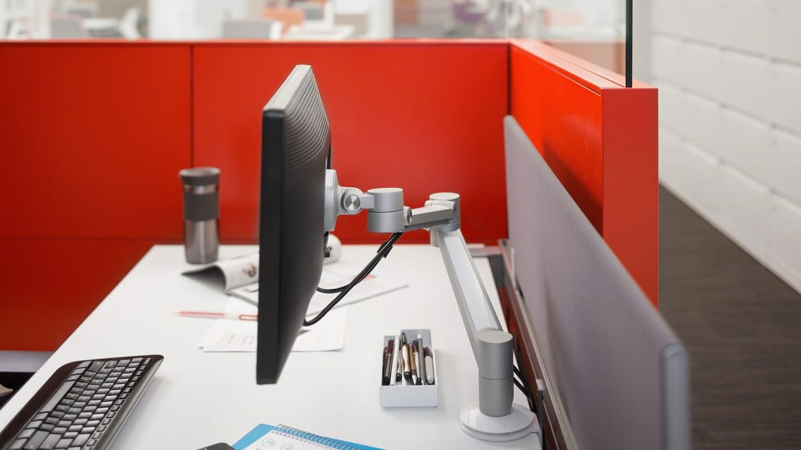 Volley Flat Panel Monitor Arm in a workstation with red partitions
