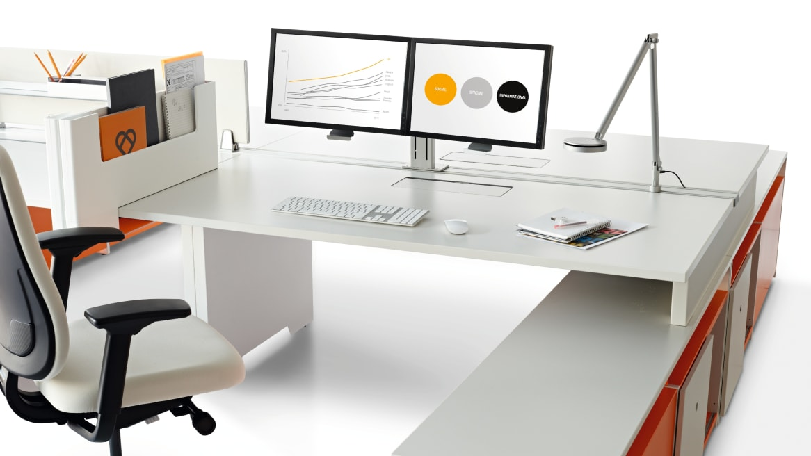 Plurio Dual supporting two monitors on a desk