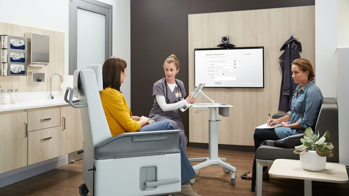 Female doctor speaking to a female patient in an Empath Recliner