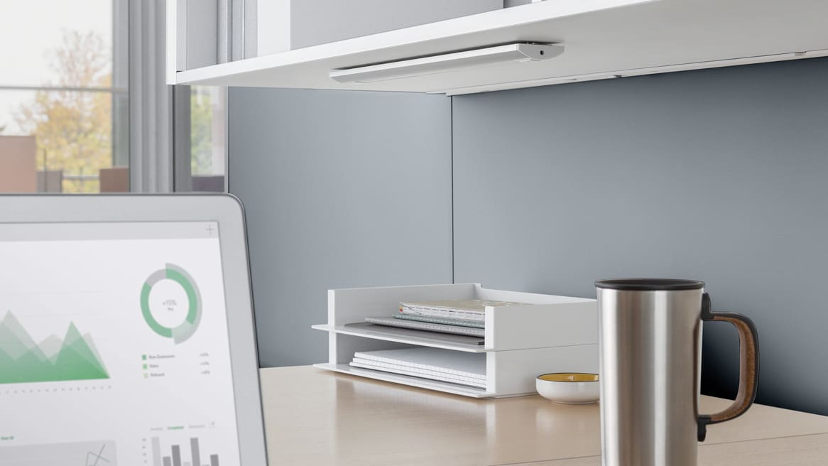 LED Linear Shelf light mounted under a overhead storage at a workstation