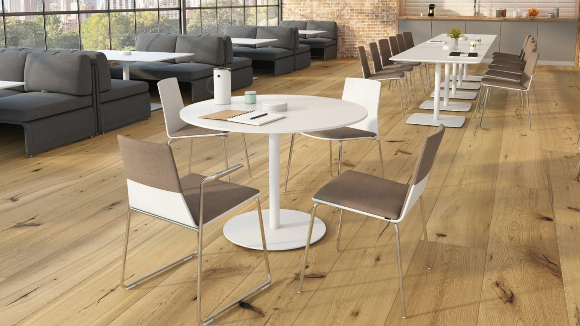 Open space with brown Montara650 chairs and white tables.