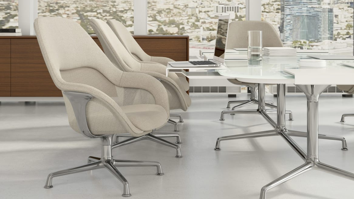 Four white SW_1 Seating in a meeting room, glass table with a laptop on it