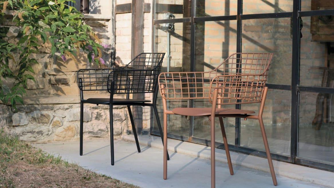 two metal Emu Lyze chairs