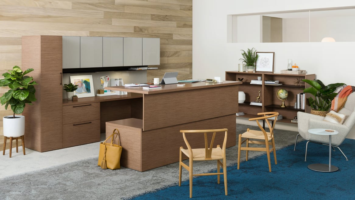 Private office with wooden desk and storages, white Gesture chair.