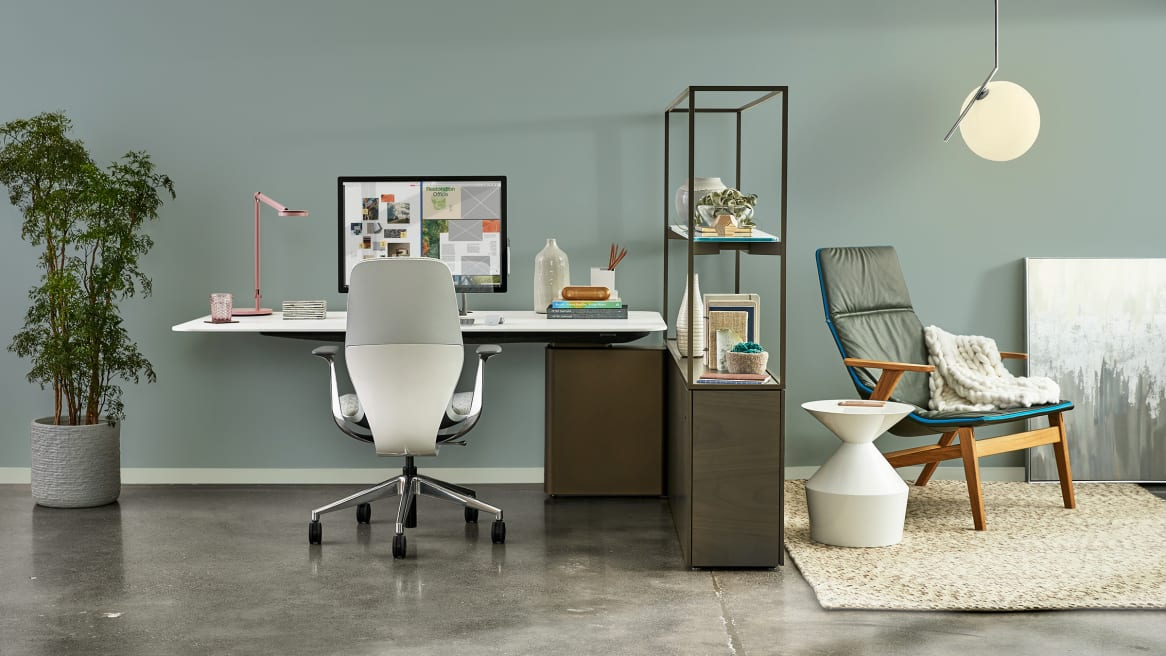 Mackinac workstation with SILQ chair with a lounge next to it featuring Viccarbe Ace Chair