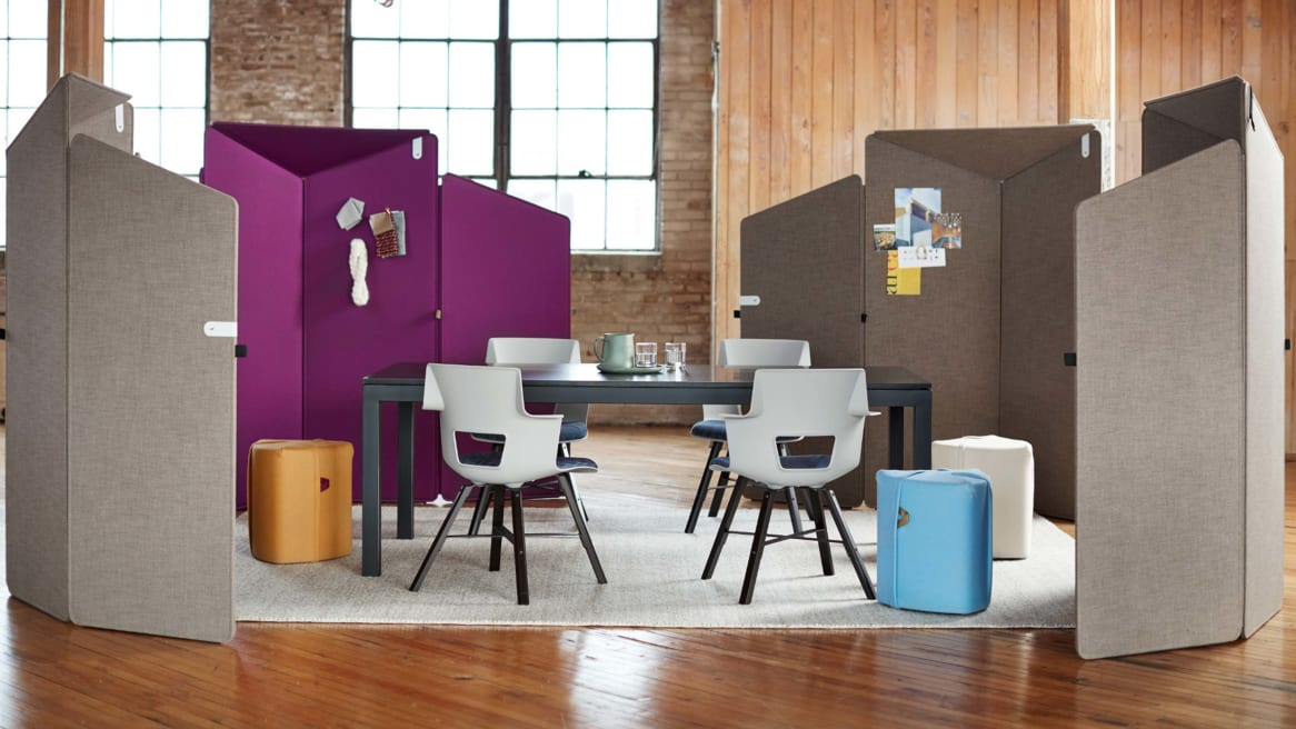Gray and purple Clipper screens surround a yellow Campfire Pouf and Shortcut Wood chairs next to a table