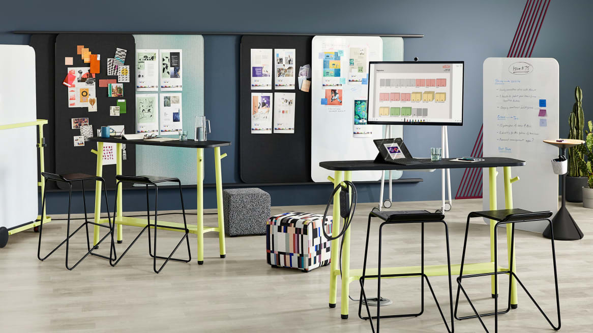 Workplace meeting area featuring Steelcase Flex Slim Tables, Blu Dot Ready barstools, Viccarbe Season Poufs, Flex Markerboards, Flex Screens, Flex Stand, Flex Board Cart, and Flex Power Hanger
