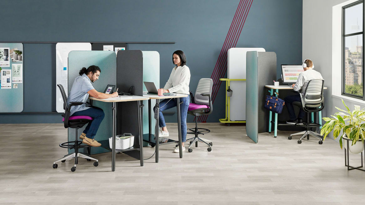 Steelcase Flex products are used to create spaces for solo work, including Flex standing height tables, and Flex screens Steelcase Series 1 stool height seating is also featured