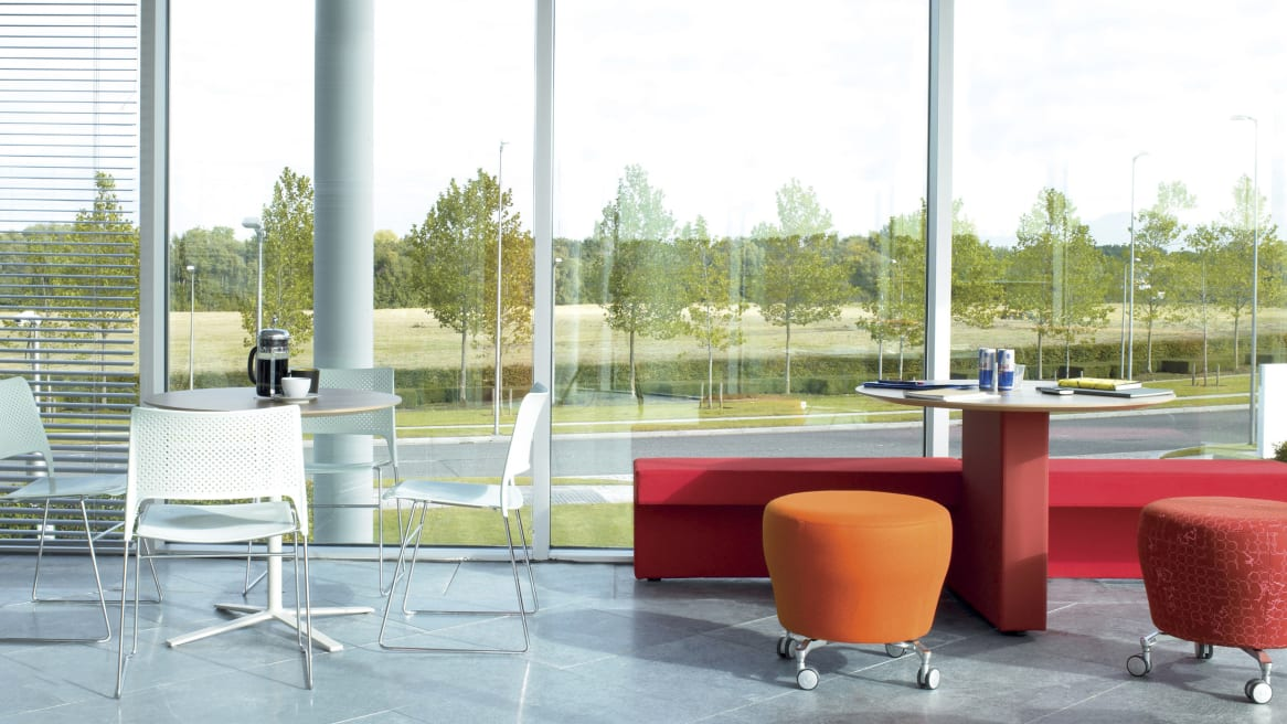 Orangebox Border seating is seen in a collaborative space in an office setting