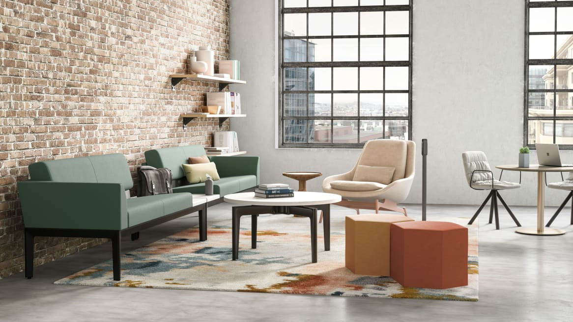 A Green Surround lounge with a Bassline table and Blu Dot Field Lounge chair