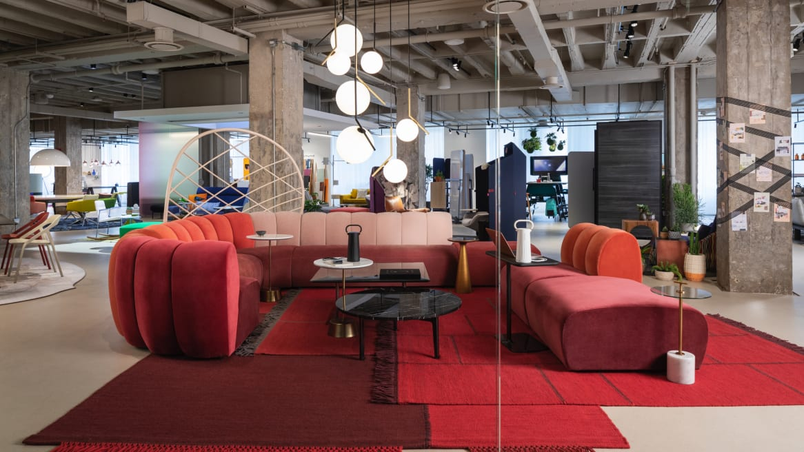 A lounge setting is created using West Elm Work Belle lounge seating, Horizon and Maisie tables, and side tables from the Mitchell Gold + Bob Williams partnership with Steelcase