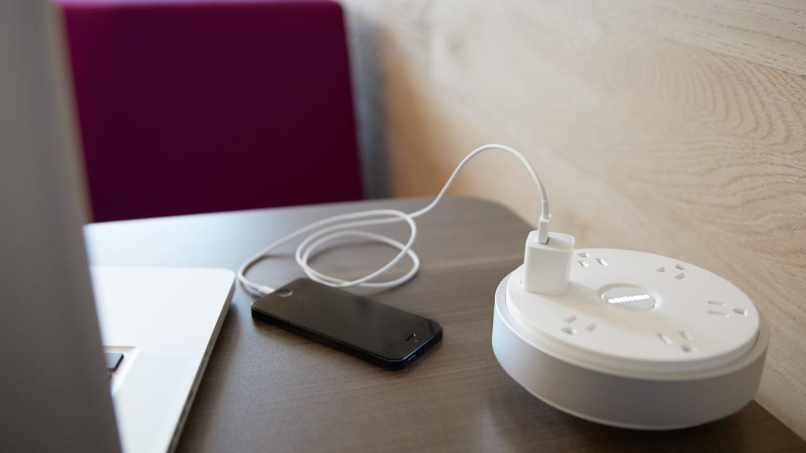 PowerPod unit charging a phone