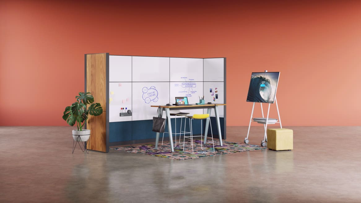 Open Active Collaboration space equipped with Answer Panel System, B-Free Standing Height Table, Microsoft Surface Hub Roam Cart and a colorful Moooi rug