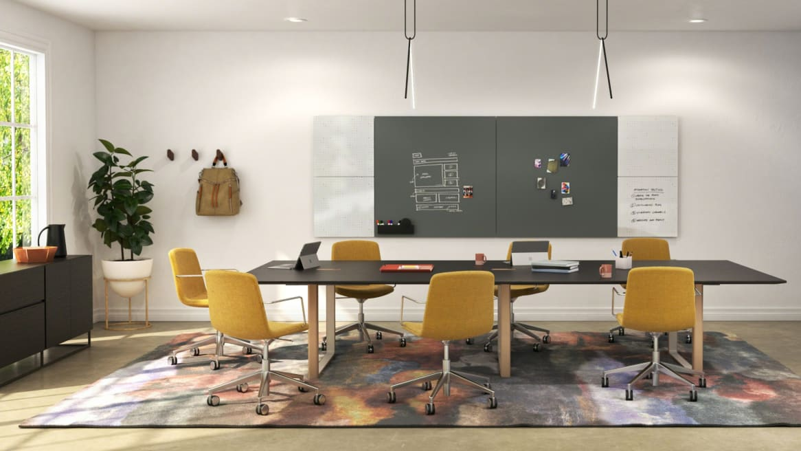 Private collaborating room with large Verlay table and yellow chairs around
