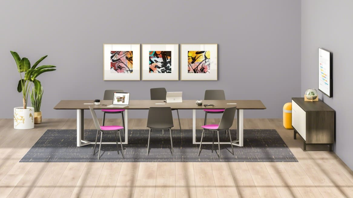Verlay Conference Room with wooden table and office chairs
