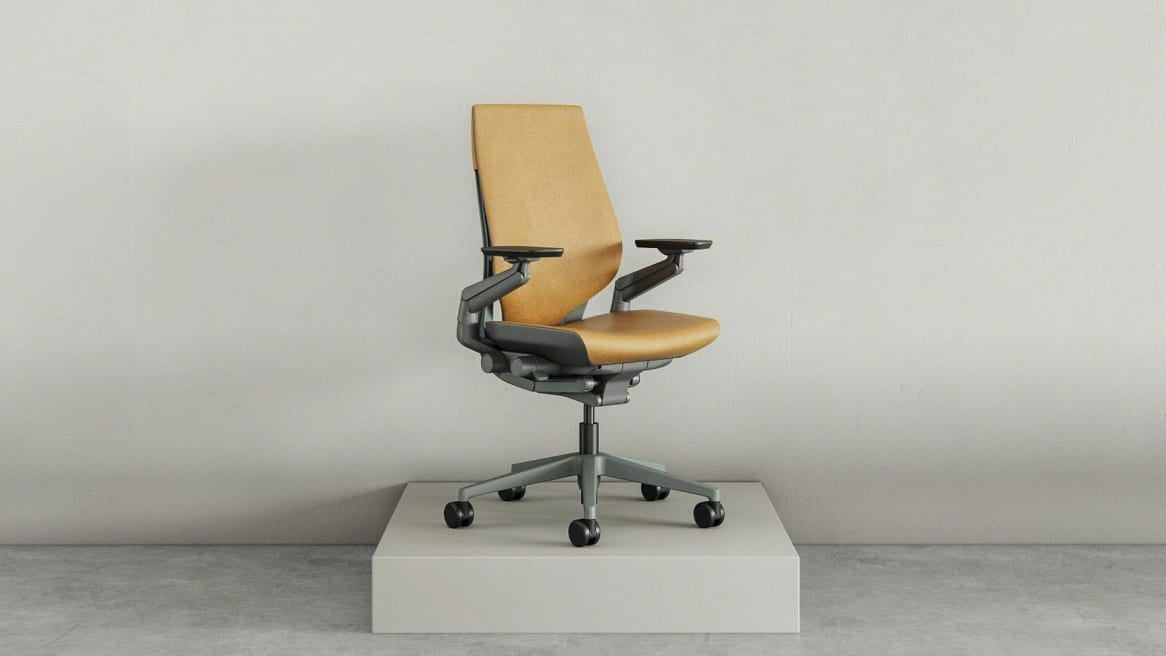 Front view of a yellow Gesture chair on a pedestal