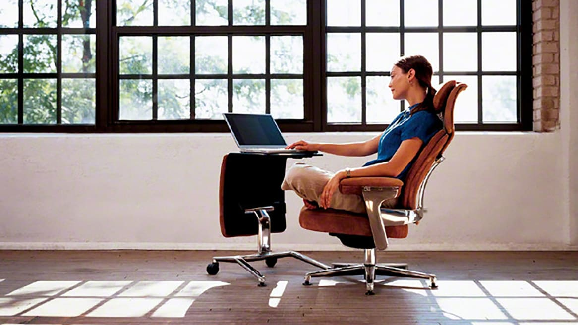 Woman seating in a Leap chair with her laptop