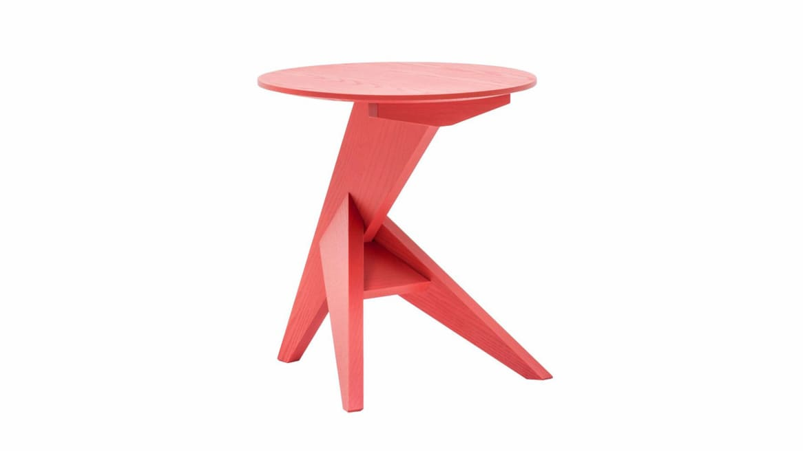 A red Mattiazzi Medici Table on white background