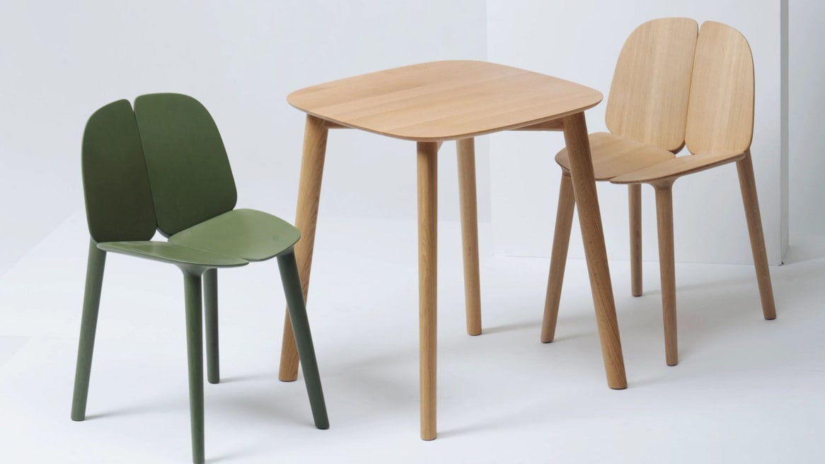 A green and a natural ash Osso Chairs by Mattiazzi in front of a light wood Osso Table