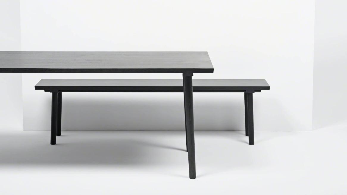facile table in a black ash color