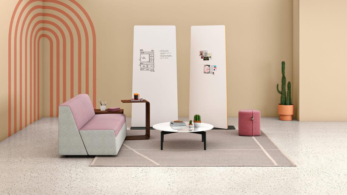 two pivot screens inside a beautiful room with a sofa